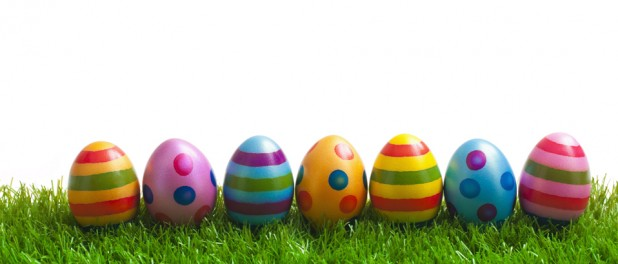 painted easter eggs lined up on grass