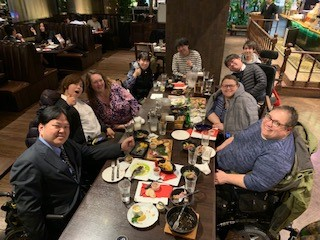 Susan Stahl and advocates dine with Mr. Satoshi of DPI-Japan